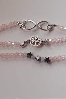 Czech crystal bracelet with pendants tree of life, infinity and stars from hematite